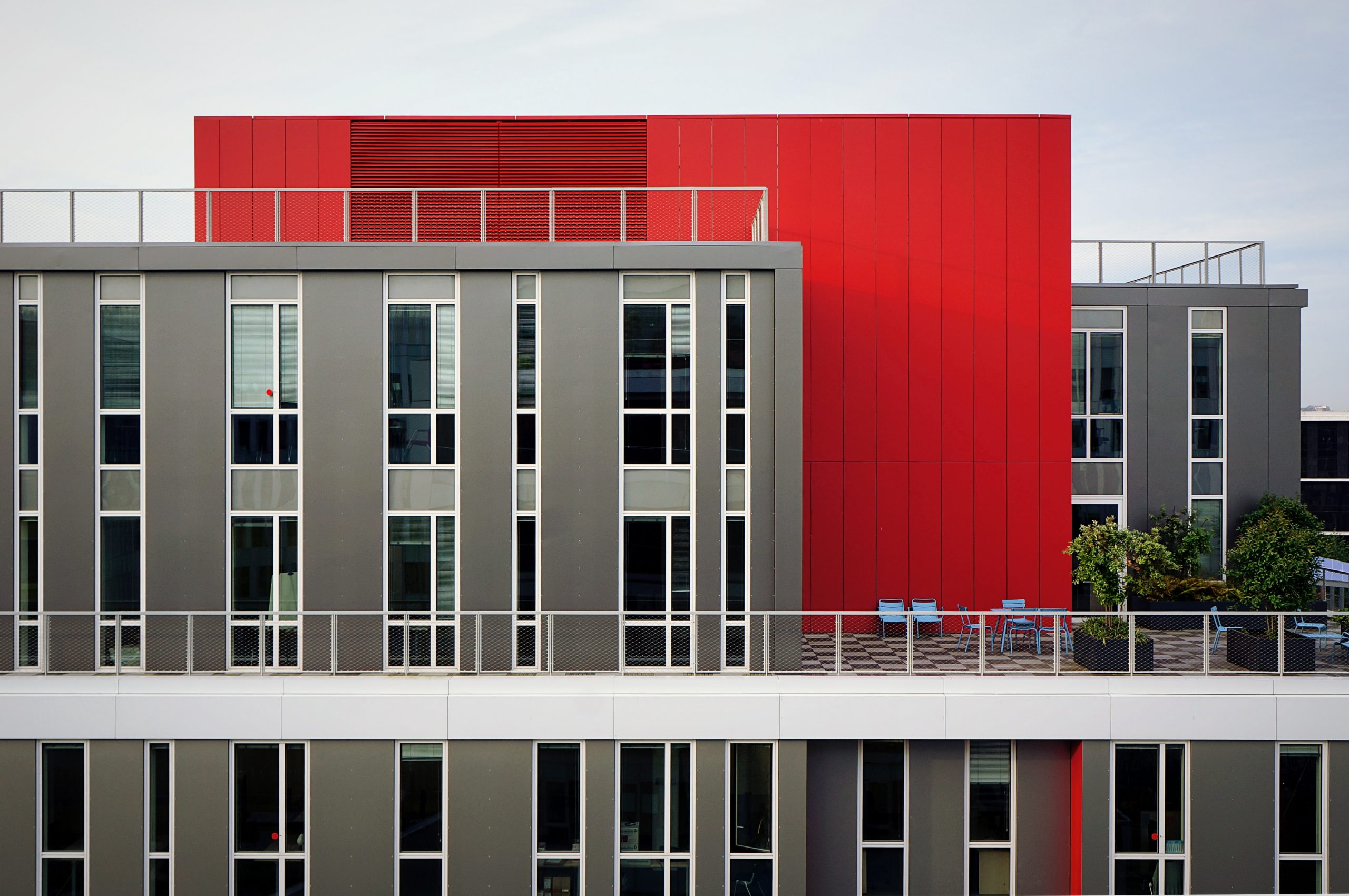 Painted grey and red commercial building