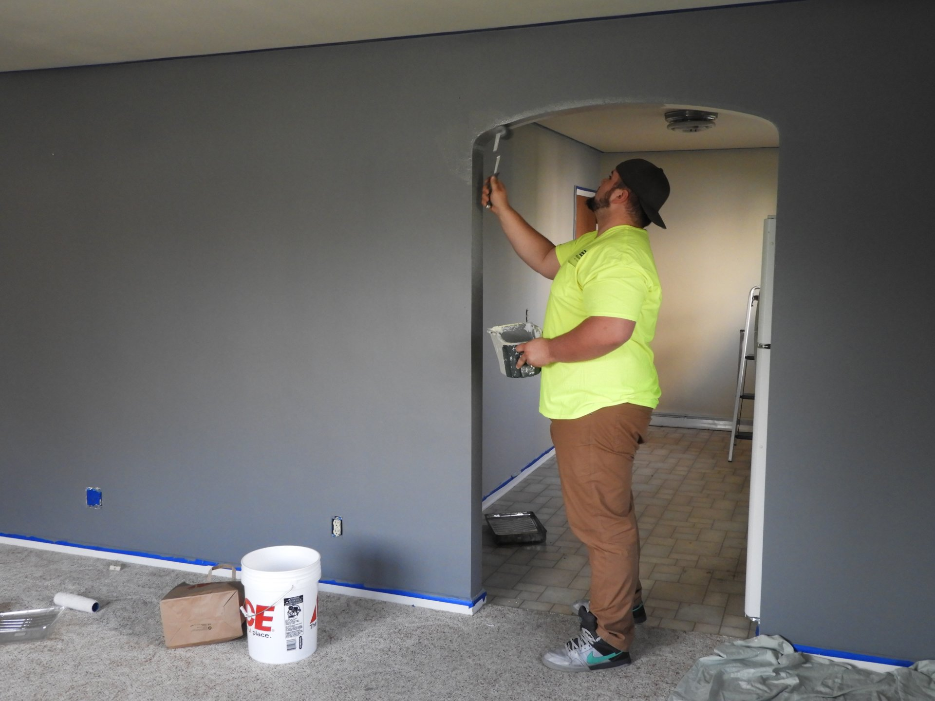 Painting guy painting room grey