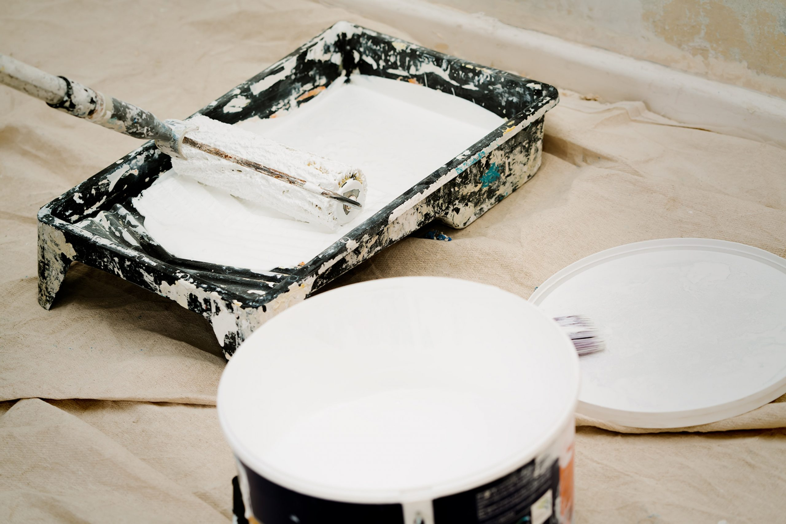 Painters Using White Paint and Rollers