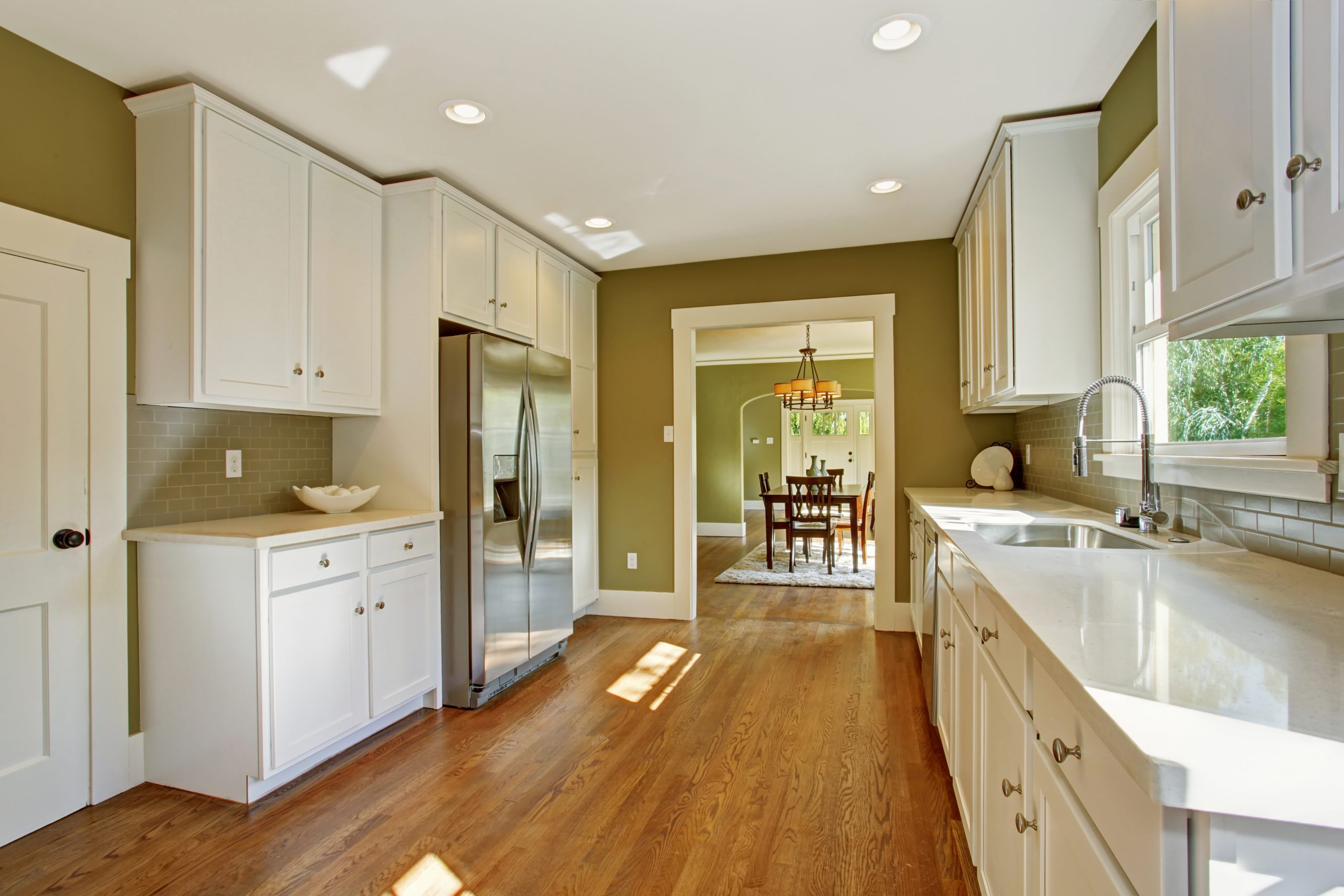 Large narrow green painted kitchen